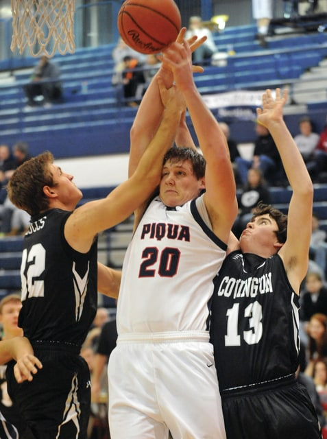 Call File Photo Nate Monnin is fouled as he fights for a rebound against Covington's Robert Gengler (32) and Trevor Miller (13) during last year's Buckeye Insurance Group Holiday Classic at Garbry Gymnasium.