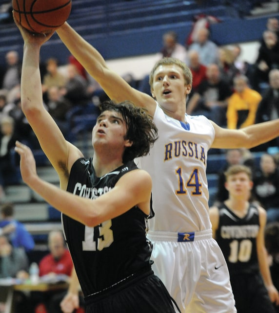Mike Ullery | Daily Call Covington's Trevor Miller, 13, puts up a shot against Russia's Jake Gariety, 14.