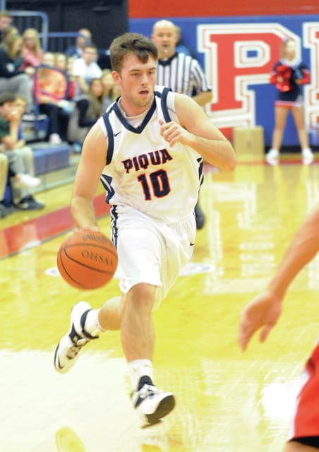 Mike Ullery   Daily Call Derrick Gullett, 10, brings the ball down the floor for the Indians.