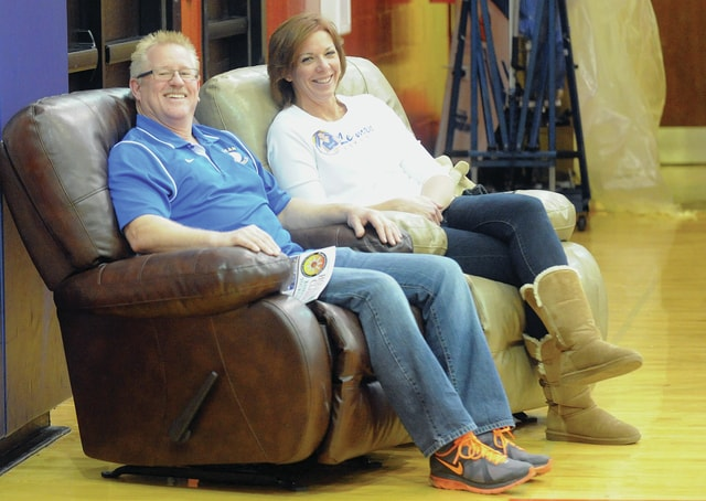 Mike Ullery | Daily Call Doug and Juli Smith of Piqua won the opportunity to sit in courtside recliners during the Russia vs. Lehman basketball game at the Buckeye Insurance Basketball Classic at Garbry Gym on Wednesday. The drawing was sponored by Town and Country Furniture and WPTW radio.