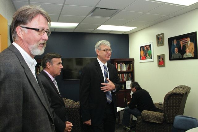 Chancellor John Carey of the Ohio Department of Education during his campus tour of Edison State Community College in the Veteran's Lounge on Monday. From left to right: Tom Milligan, vice chairman of the board of trustees; Darryl Mehaffie, chairman of the board of trustees, and Chancellor Carey.