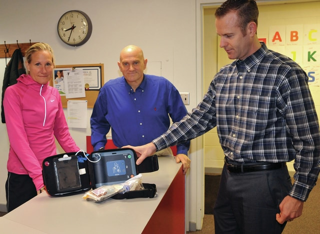 Libraries to receive AED machines Mike Ullery | Staff Photo The use of the YMCA's AED by Jim McMaken, right, helped save the life of Kevin Pryfogle, center. Sue Peltier is at left.