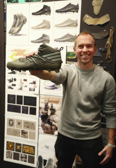 Photo by Nick DePaula Tom Hartings, formerly of Piqua, shows off his newest shoe design for adidas, a nod to Pat Tillman's legacy with the Army Rangers.