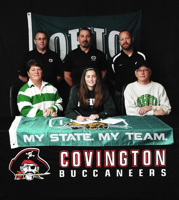 Ben Robinson/GoBuccs.com Carly Shell signed a letter of intent this week to run for Ohio University. In front with Shell are her mother Kim and father John. In back (left to right) are Superintendent Gene Gooding, Dave Tobias (girls track and field coach), Josh Long (cross country coach).