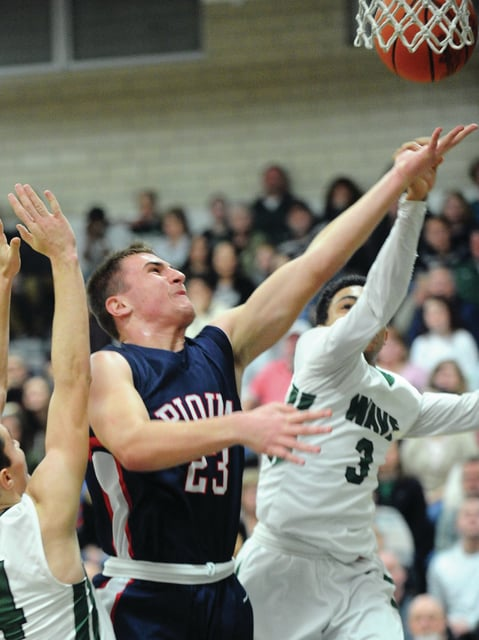 Mike Ullery | Daily Call Piqua's Ben Sshmiesing, 23, fights to get off a shot against Greenville.