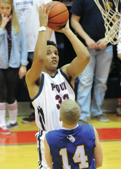Mike Ullery | Daily Call Tyren Cox, 33, puts up a jump shot for Piqua.