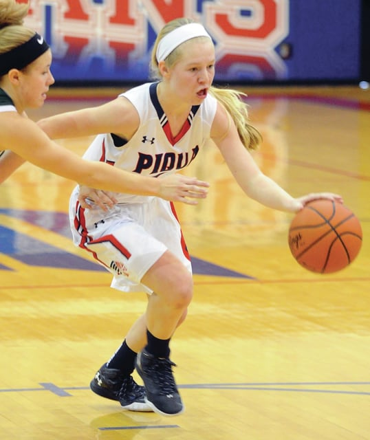 Mike Ullery | Daily Call Lauren Williams, 1, drives the lane for Piqua.