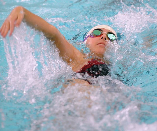 Mike Ullery | Daily Call Piqua Allie Cox swims the 50 meter backstroke event at Trotwood on Saturday.
