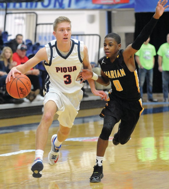 Mike Ullery | Daily Call Brad Hohlbein, 3, brings the ball down the floor for the Indians.