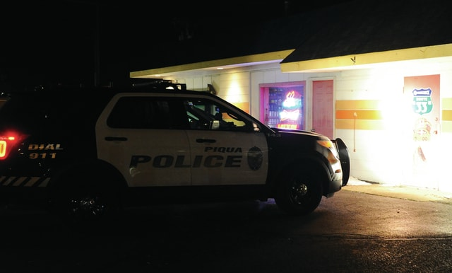 Mike Ullery | Daily Call Piqua police investigate an armed robbery at the Sunset Drive Thru on Sunset at Commerce Drive on Monday evening.