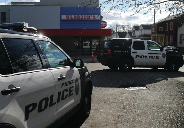 Mike Ullery | Daily Call Piqua police converge on Ulbrich's Market on Wayne Street in Piqua on Monday afternoon following a reported armed robbery at the grocery.