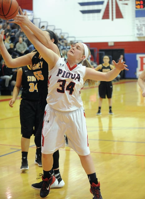 Mike Ullery |Daily Call Piqua's Mikayla Schaffner (34) reaches for the ball Wendesday night at Garbry Gymnasium.
