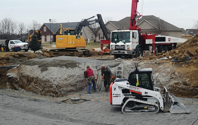 Mike Ullery | Daily Call A break in the weather gave crews from Woehrmyer Concrete in Minster the opportunity to get a footer poured for a new home on Caribou Court in Piqua on Wednesday afternoon.
