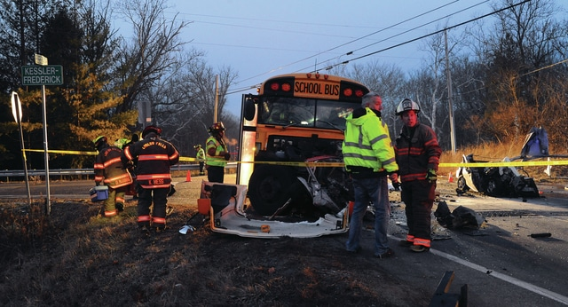 Mike Ullery | Daily Call EMS crews from multiple departments and Miami County deputies work the scene of a crash involving a Milton-Union School bus and a car at the intersection of St. Rt. 55 and Kessler-Frederick Road on Thursday morning.