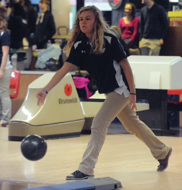 Mike Ullery | Daily Call Katie Sherman looks to roll a strike for the Indians.