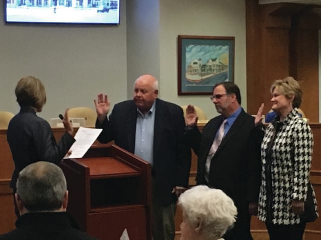 City Attorney Stacy Wall (left) leads the oath of office for Commissioner Bill Vogt, Commissioner John Martin, and Commissioner and Mayor Kazy Hinds.