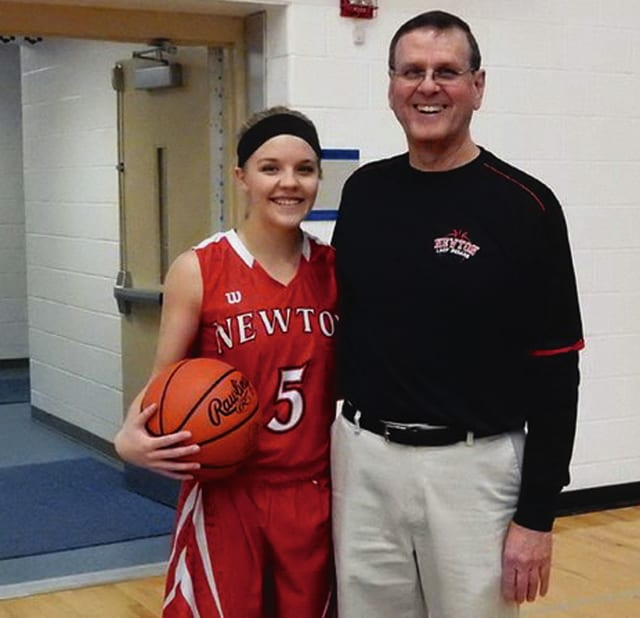 Tim Alley/Civitas Photo Newton's Madison Mollette is shown with coach Neal Hans after becoming the girls all-time leading scorer Thursday night.