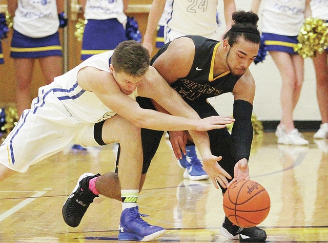 Lehman's #55 Michael Bunker, left, and Sidney's #21 Allec Gordon chase down a loose ball at Lehman Saturday.  Luke Gronneberg | Sidney Daily News