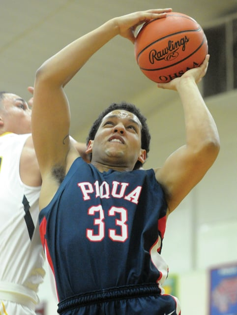 Mike Ullery | Daily Call Piqua's Tyren Cox, 33, puts up a shot against Sidney.