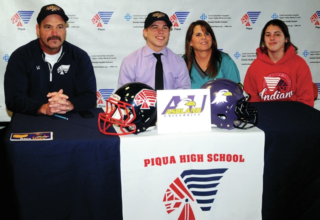 Mike Ullery | Daily Call Piqua senior Alex Nees, second from left, signed his National Letter of Intent on Wednesday to play football for Ashland University. Pictured with Alex is his dad, Piqua head football coach Bill Nees, his mom Velvet, and his sister Emma.