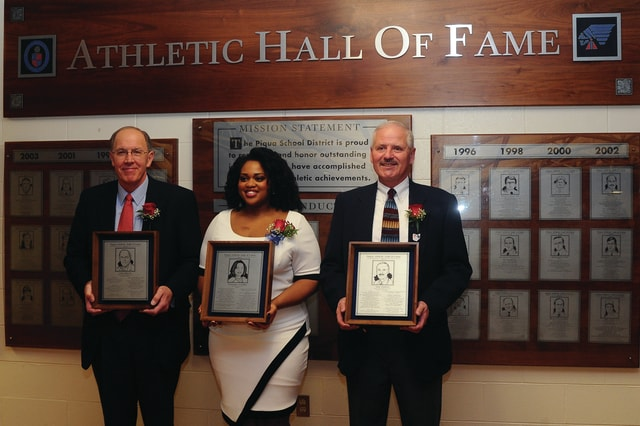 Piqua High School added three honorees to the Piqua Athletic Hall of Fame during ceremonies at Garbry Gym on Friday. John Hinsch, Desanbra Franklin, and Dan Dunton were selected as the Class of 2015. Hinsch, a 1969 Piqua Central graduate was a standout in both baseball and basketball. Franklin graduated from PHS in 2006 and played softball for the Indians. Dunton was a member of the PCHS Class of 1973 and earned honors in both track and cross country.