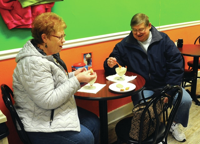 Mike Ullery   Daily Call Judy and Bob Bearbower of Englewood enjoy a dish of ice cream at Susie's Big Dipper in Piqua on Tuesday afternoon. The couple traveled to Piqua, stopped at the Miami Valley Centre Mall, and explored downtown before indulging in Susie's ice cream, which they both declared to be worth another trip to Piqua.