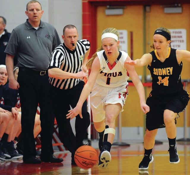 Mike Ullery | Daily Call Piqua's Lauren Williams, 1, races down the floor as she is pursued by Sidney's Ashley Egan and an official.