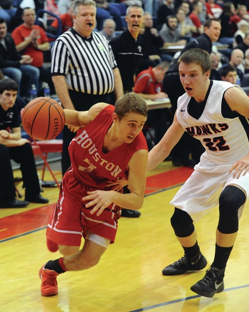Houston's Zack McKee, 5, drives around Mississinawa's Devan Rinderle, 22.
