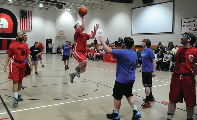 Mike Ullery | Daily Call Mathew Dunlap, 37, puts up a shot at Riverside on Friday as the Miami County Special Olympics basketball team squared off against the Interactive Media students from the Upper Valley Career Center. The annual event draws a large crowd to watch the event.