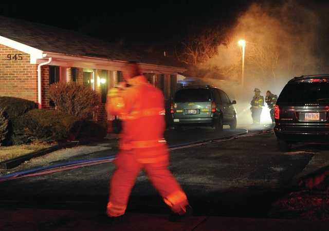 Mike Ullery | Civitas Media Troy firefighters work to extinguish a fire in an apartment at 945 North Dorset Street on Monday evening.
