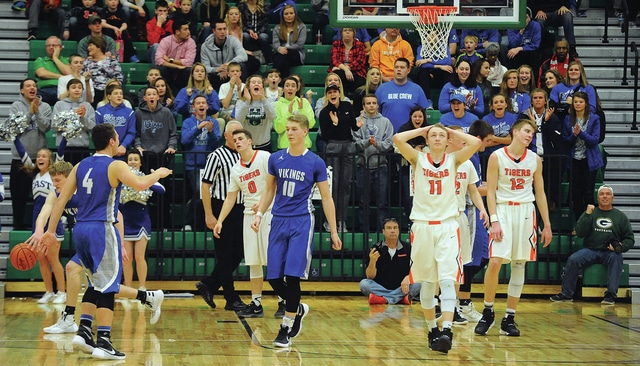 Mike Ullery | Daily Call Fans and players from Miami East and Versailles react to final score of a typical, hard-fought, game between the two schools. The Vikings held on for a 51-49 win in the boys DIII section final at Northmont on Saturday.