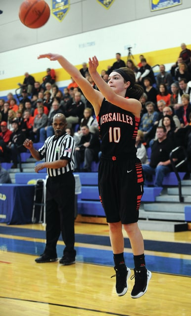Mike Ullery | Daily Call Kami McEldowney, 10, sinks a three-pointer for Versailles.