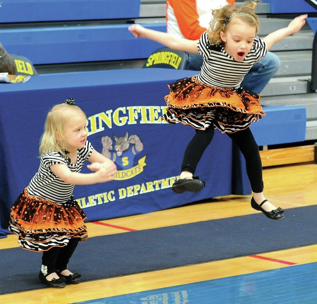 Mike Ullery | Daily Call Remy, 2, and Reagan, 4, Raterman lead cheers for the Versailles Lady Tigers following a sectional title win at Springfield High School on Saturday. The youngsters are nieces of Tigers' head coach Jackie Stonebreaker.