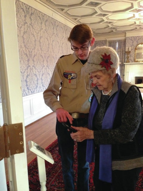 Provided photo Matthew Jackson shows his grandmother, Mrs. Lee Jackson, how to access the QR code tour from her smartphone. Matthew's Boy Scout Eagle Scout Award service project uses web-based technology to provide a self-guided tour of the Troy-Hayner Cultural Center.