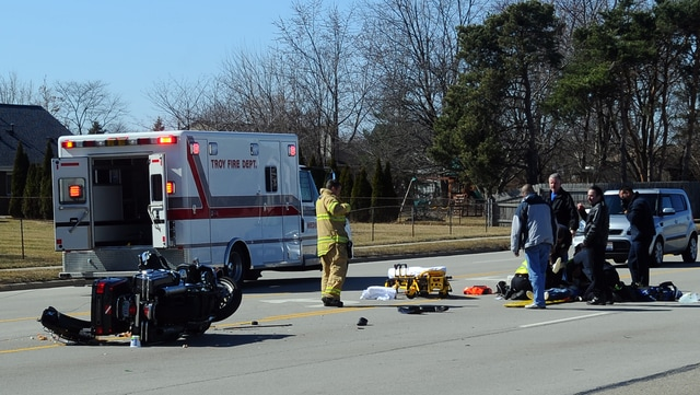 Mike Ullery | Civitas Media Troy police, fire, and medics, work the scene of a two-vehicle crash on West Main Street on Monday afternoon.