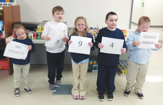 The students and staff of Nicholas School, a part of the Hahn-Hufford Center of Hope, collected canned goods to donate to the Bethany Center in Piqua to celebrate their 100th day of school on Jan. 27. Their goal was to collect 100 items, and the school received 394. Nicholas School thanks everyone who donated. Students pictured from left to right are Izabella, Ethan, Paige, Dominic, and Caleb. (Last names of students are not given out.)