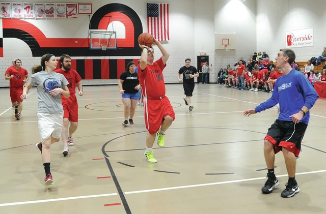 Mike Ullery | Daily Call Jason Benton, 35, of the Riverside of Miami County Special Olympics men's team puts up a shot vs. Upper Valley Career Center Interactive Media students during a recent ball game.