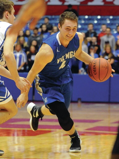 Mike Ullery | Daily Call Ryan Haney, 4, brings the ball down the floor for Miami East.