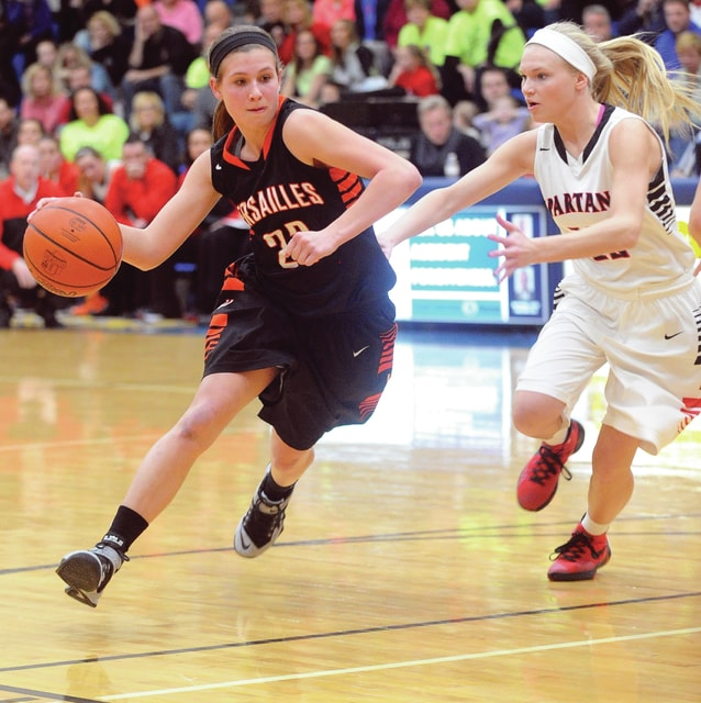 Mike Ullery | Daily Call Versailles' Ellen Peters, 23 drives against Ashley Anderson Saturday.