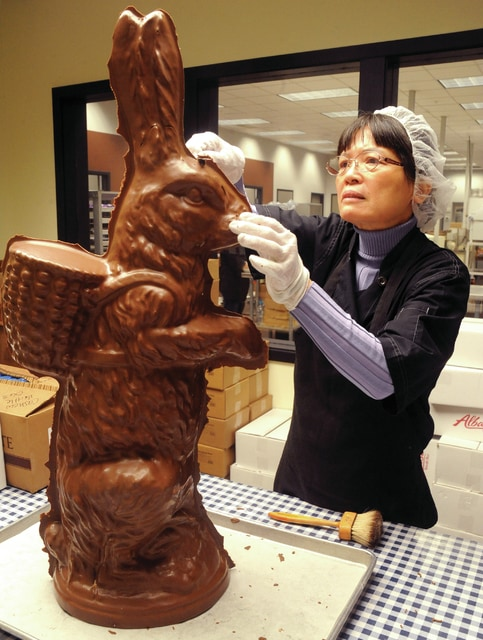 Mike Ullery | Daily Call Longne Harvey trims excess chocolate from a Winan's giant Easter bunny at the downtown business on Thursday. The bunnies, which are an Easter tradition at Winan's, are available while supplies last. Harvey has been an employee at Winan's for the past 13 years.