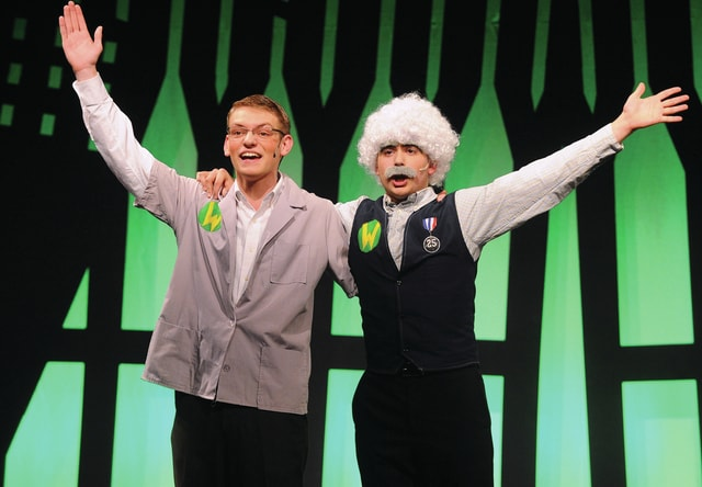 "Mike Ullery | Daily Call J. Pierpont Finch, played by Nathan Teeters, left, and Wally Womper, played by Jackson Tucker, perform a musical number as part of the 2016 Miami East High School music department presentation of ""How to Succeed in Business Without ReallyTrying""."