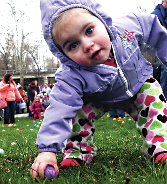 Mike Ullery | Daily Call Shania Tamplin, age 16 months, finds an Easter Egg at the annual Fields of Grace Worship Center Easter Egg Hunt was held at the Covington City Park on Saturday. Tamplin, who is from Bradford was with her mom Ashley Moss.