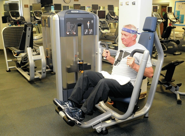 Mike Ullery | Daily Call Piqua resident Gene Hill works out on one of the new pieces of exercise equipment recently installed in the Fitness Center at the Piqua branch of the Miami County YMCA. Hill has been a member of the Miami County YMCA for the past 53 years.