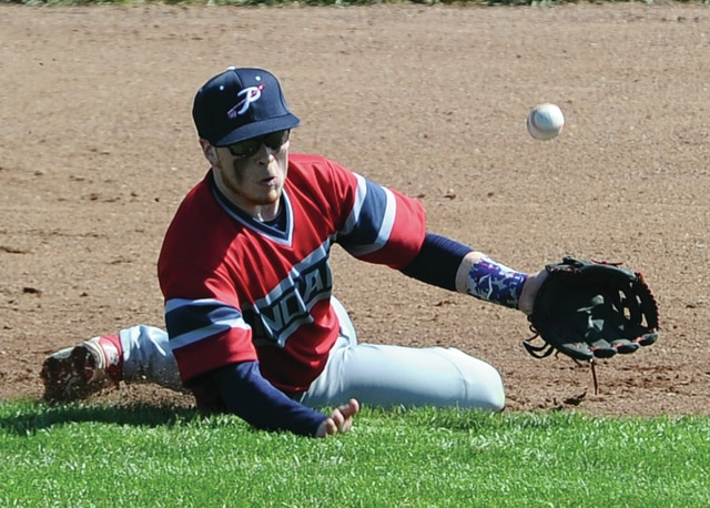 Mike Ullery | Daily Call Logan Harris, 7, makes a sliding attempt at a ground ball from his third-base position.