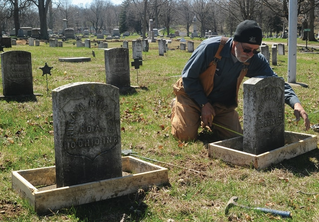 Mike Ullery | Daily Call David Wright from Forest Hill Union Cemetery and Arboretum levels a cement form in the original Veteran's Section of the cemetery. Wright and co-worker Logan Guillozet are preparing more than 150 graves of veterans, mostly from the Civil War era, for new cement support bases to help stabilize the headstones. The section is one of three Veteran's sections in the cemetery.