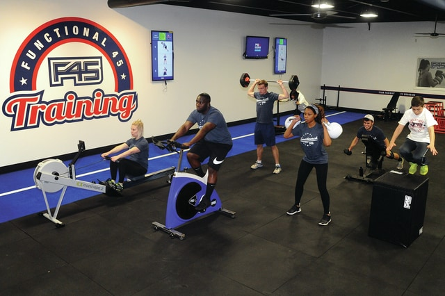 Mike Ullery | Daily Call Functional 45 Training instructors demonstrate some of the workout options that will be available at the new training center when it opens on Monday. The Piqua location, owned by Holly and Josh Trombley of Piqua, is the largest F45 center in Ohio.