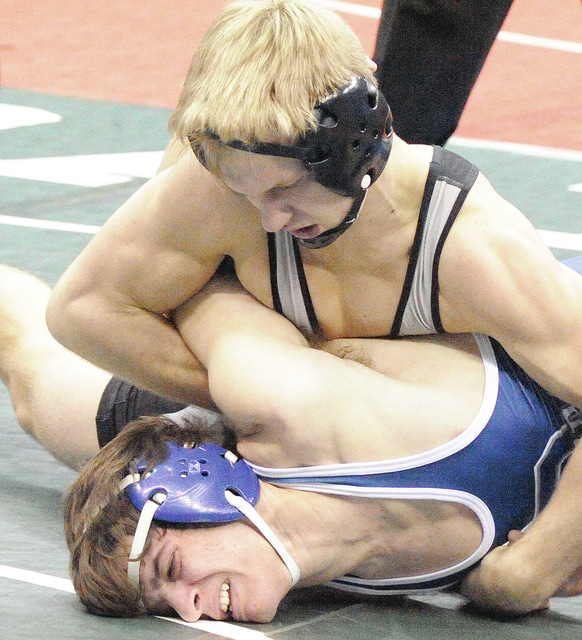 Anthony Weber/Civitas Media Covington's Ryan Ford controls Brandon Huffman of Rootstown on his way to his 200th win.