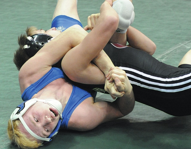 Anthony Weber | Civitas Media Miami East's Graham Shore battles Julian Sanchez from Genoa Area Saturday morning at the Schottenstein Center at the Division III Individual State Wrestling tournament. Shore finished third at 113-pounds.
