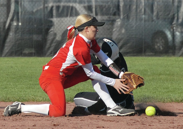 Anthony Weber/Civitas Media Covington's Justice Warner steals second as Newton's Maddie Mollette reaches for the ball.