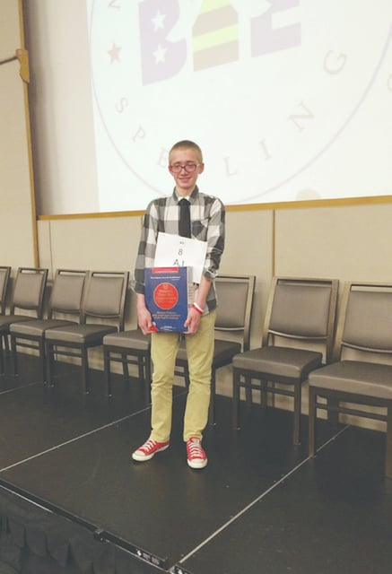 Miami East eighth grade student AJ Christian winning the Dayton Collaborative Spelling Bee in February.
